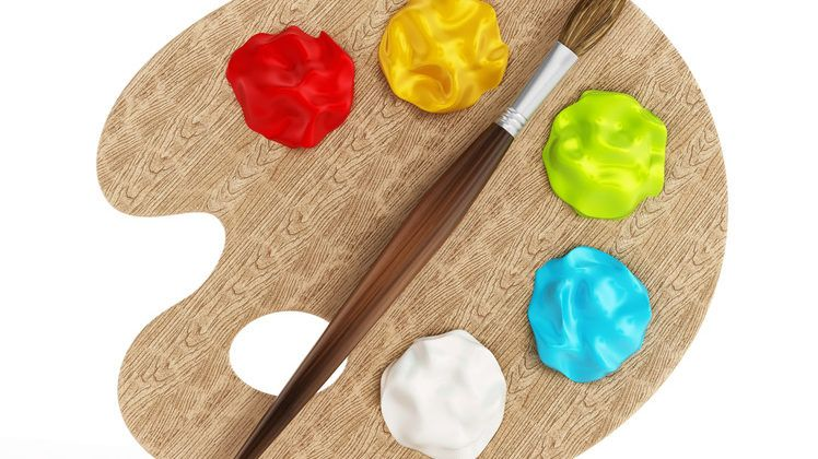 Palette, paints and paintbrush isolated on white background